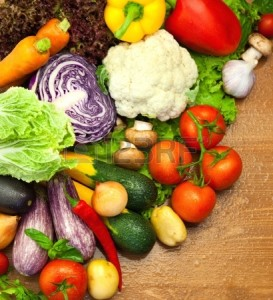 14558926-assortment-of-fresh-organic-vegetables--on-the-wooden-desk--with-water-droplets
